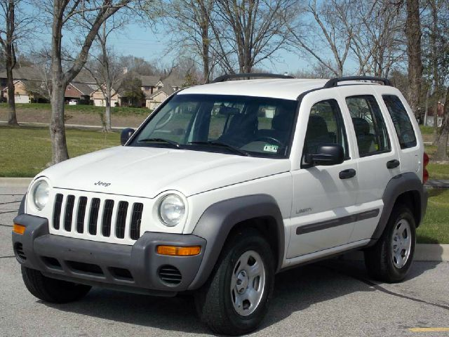 2004 JEEP LIBERTY SPORT 2WD white  all internet prices are reduced for cash cashiers check or
