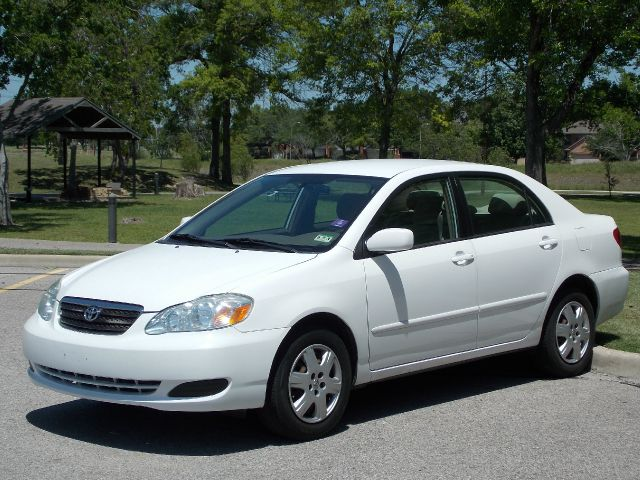 2007 TOYOTA COROLLA CE white  all internet prices are reduced for cash cashiers check or same