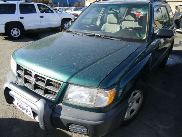 1999 SUBARU FORESTER L green 4wdawdabs brakesair conditioningamfm radioanti-brake system 4-
