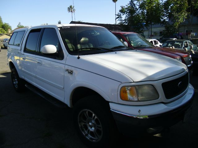 2001 FORD F150 LARIAT SUPERCREW 4WD white 4wdawdabs brakesair conditioningamfm radioanti-bra