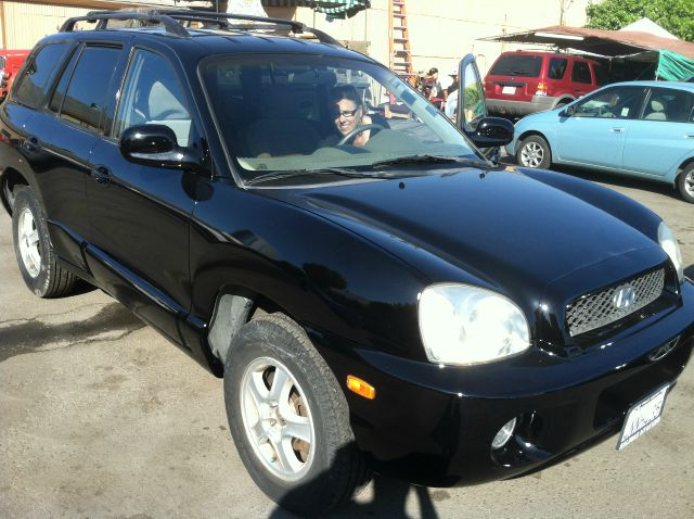 2001 HYUNDAI SANTA FE black 4 doorair conditioningamfm radioautomatic transmissioncd playerc