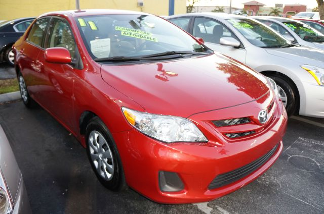 2011 TOYOTA COROLLA LE 4-SPEED AT barcelona red m abs brakesair conditioningamfm radiocd playe