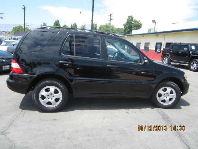 2002 MERCEDES-BENZ M-CLASS ML320 black all advertised prices are cash  tax  lic  all governm
