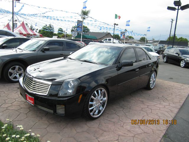 2004 CADILLAC CTS BASE black abs brakesair conditioningalloy wheelsamfm radioanti-brake syste
